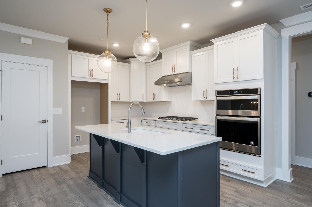 Elevation Image:Gourmet kitchen with quartz counter tops and tile backsplash