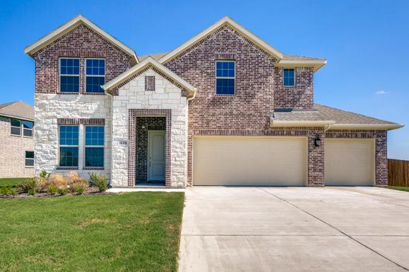 Exterior:Beautiful exterior with full front landscaping